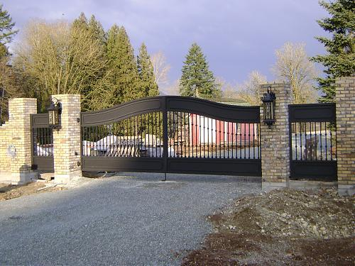 Custom order aluminum driveway gate and fencing to match.