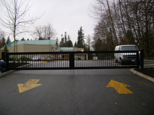Barrier double swing driveway gate for a church