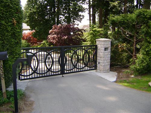 Custom ornamental driveway gate with circles